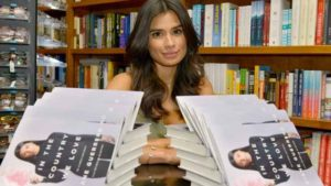 diane-guerrero-posing-with-book